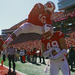 Sam Arneson celebrates a touchdown with Austin Traylor.