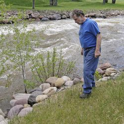 Ron Lenfield watches the fast-flowing Weber River along his property in Oakley, Summit County, on Wednesday, May 31, 2017. Authorities in Utah are ratcheting up warnings telling people to stay away from the raging, icy waterways that are extremely dangerous this spring due to a snowy winter and wet spring.