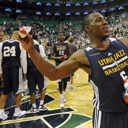 Lester Hudson throws basketballs to fans following the Utah Jazz's scrimmage in Salt Lake City, Saturday, Oct. 5, 2013.