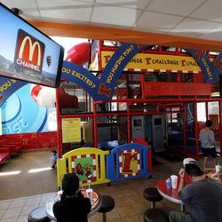 In this photo taken on Friday, Sept. 7, 2012, McDonald's patrons watch the new McDonald's television channel at a McDonald's restaurant in Norwalk, Calif. McDonald's is testing its own TV channel in 700 California restaurants in a pilot project that could expand to all the company's restaurants.