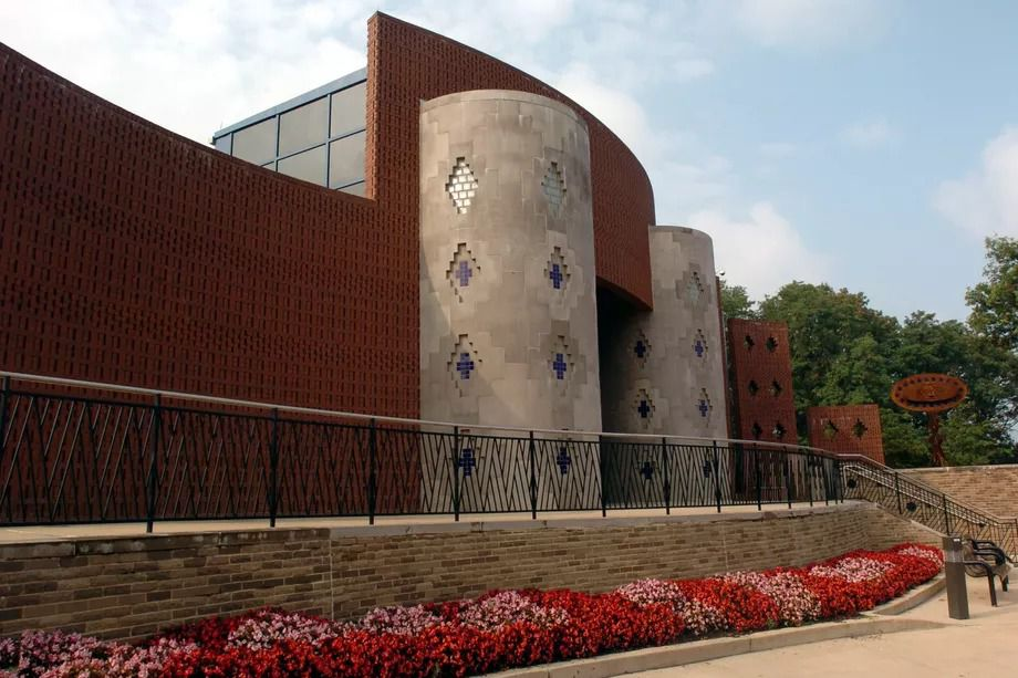 The exterior of the Anacostia Community Museum. The facade is dark red with tan.