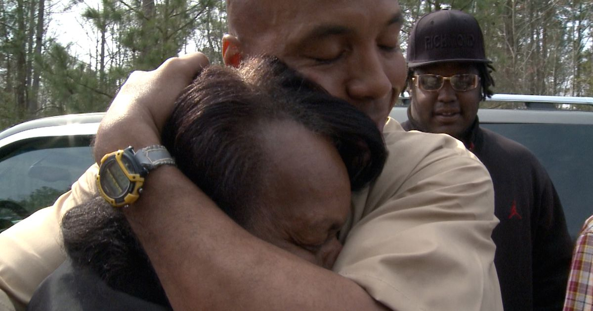 A man embraces his mother after being freed from prison.