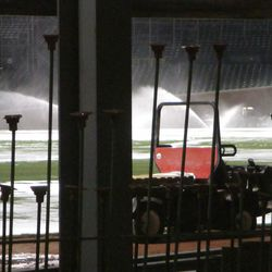 Field sprinklers on, visible through Gate Q -
