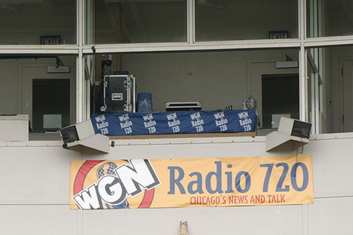 Will WGN continue to hang its logo outside this booth at Wrigley? Or will there be a new radio station name there in 2015?