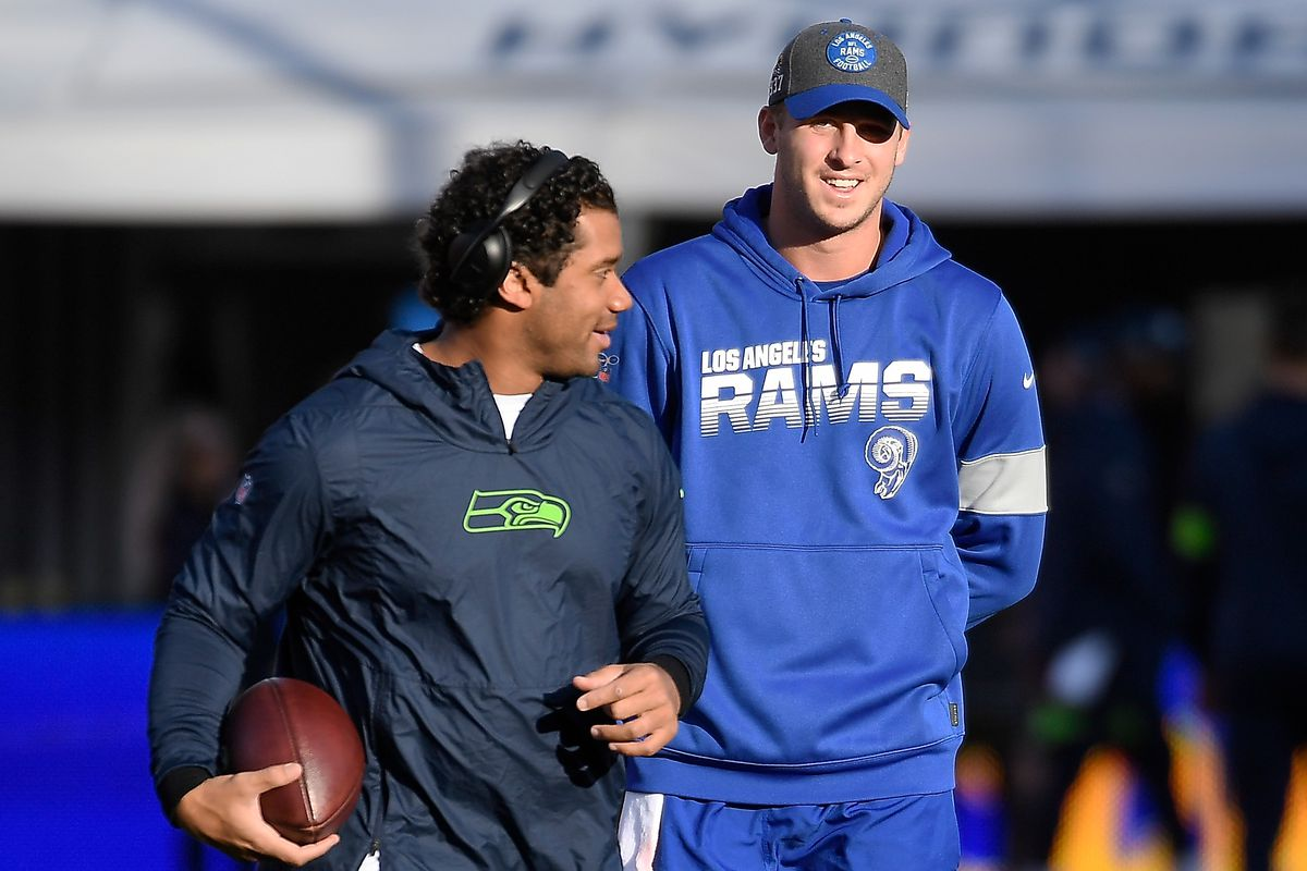 Quarterback Jared Goff #16 of the Los Angeles Rams and quarterback Russell Wilson #3 of the Seattle Seahawks talk before the game at Los Angeles Memorial Coliseum on December 08, 2019 in Los Angeles, California.