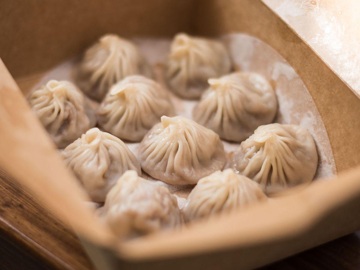 Golden Pouch dumplings in a paper box.