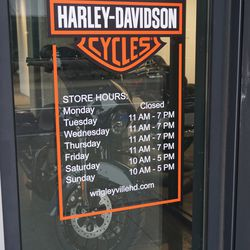 Hours posted at the soon to open Harley Davidson store, on Addison, across from Wrigley