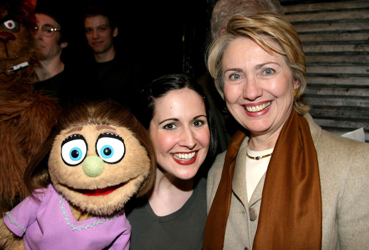 Hillary with a puppet.