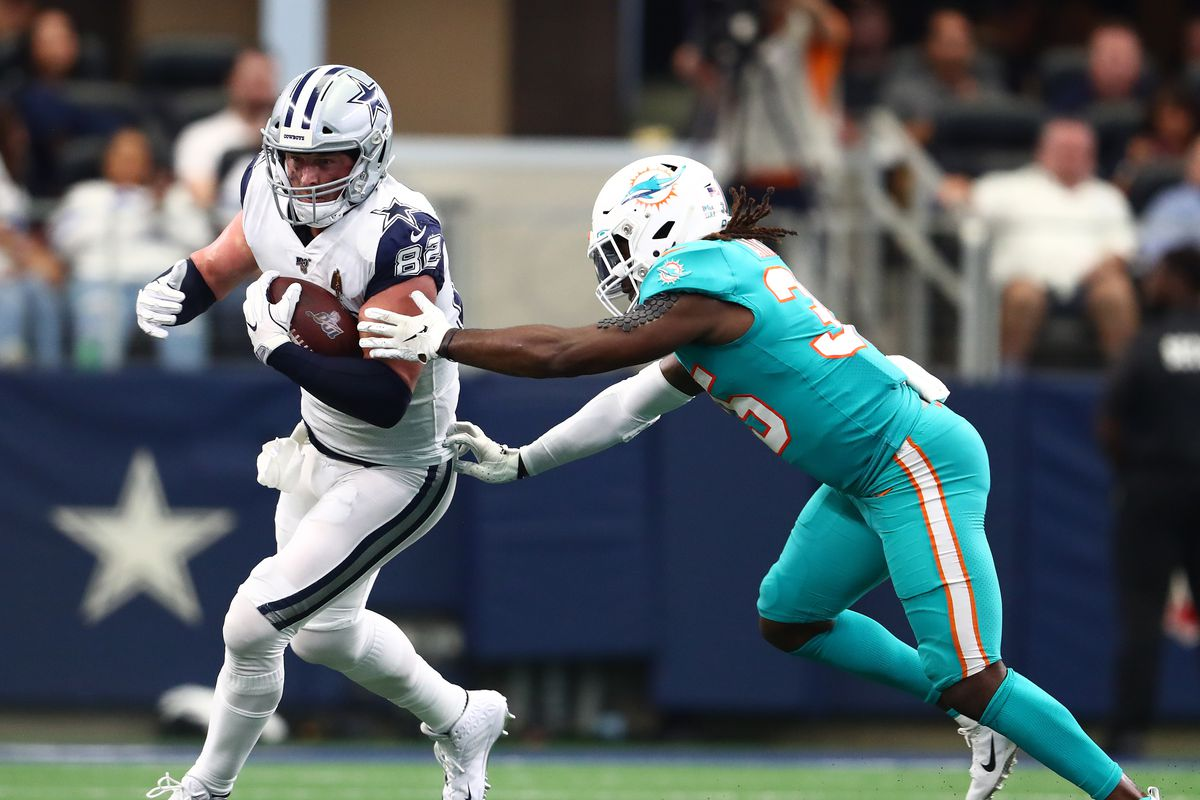 Dallas Cowboys tight end Jason Witten runs after a reception in the third quarter against Miami Dolphins safety Walt Aikens at AT&T Stadium.