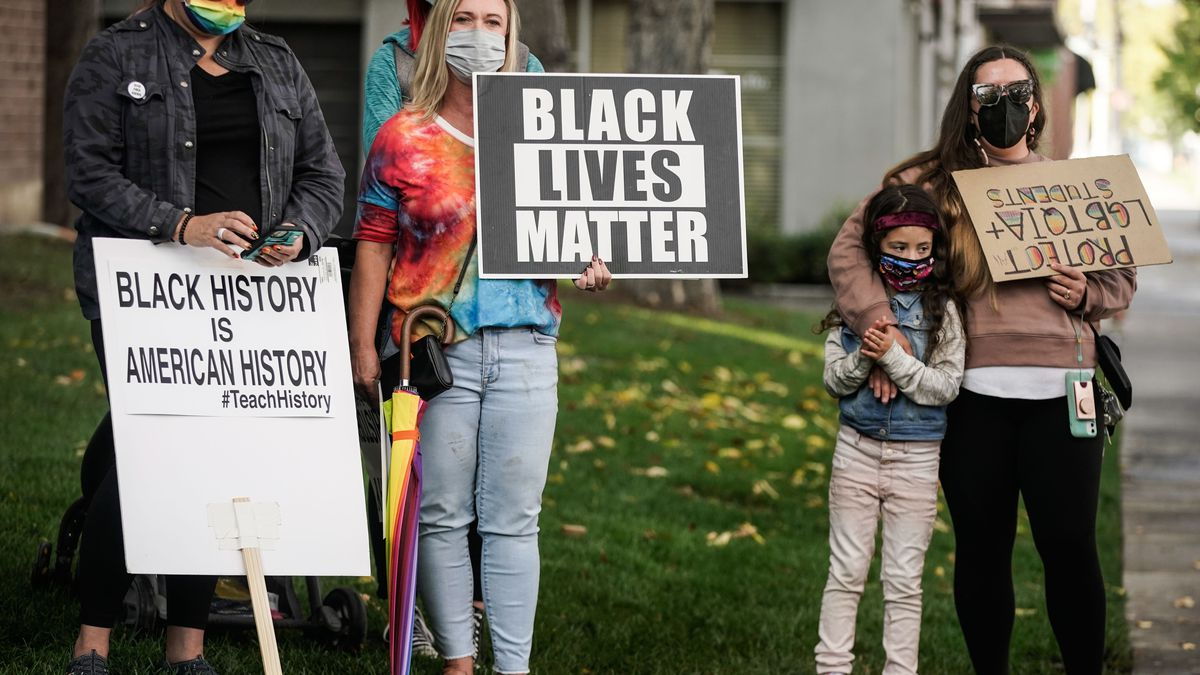 People rally in support of the LGBTQ community and teaching Black history in Salt Lake City on Thursday, Oct. 7, 2021.