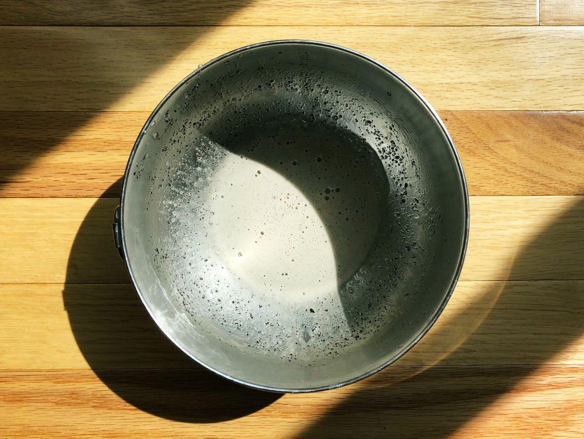 A bowl of milk tea-ish liquid.