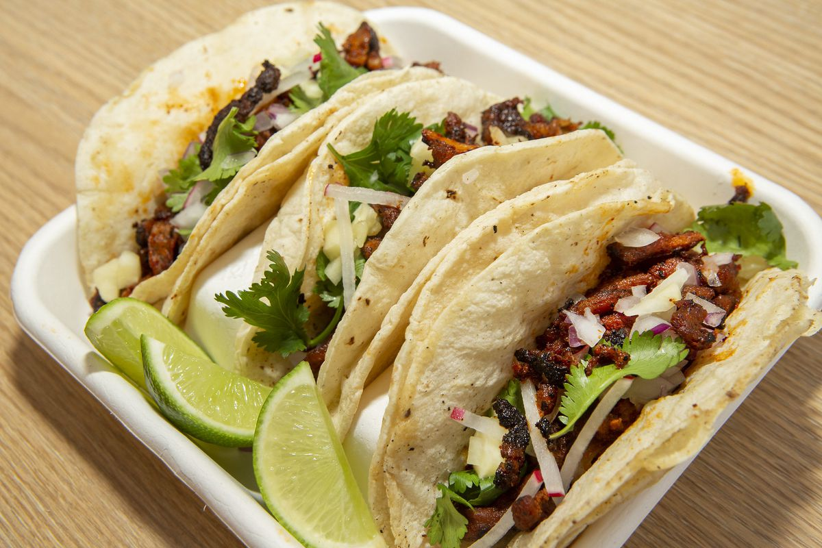 Three tacos in a plate.