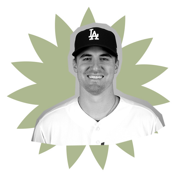 In a black and white image, Ross Stripling poses in his old Dodgers uniform.