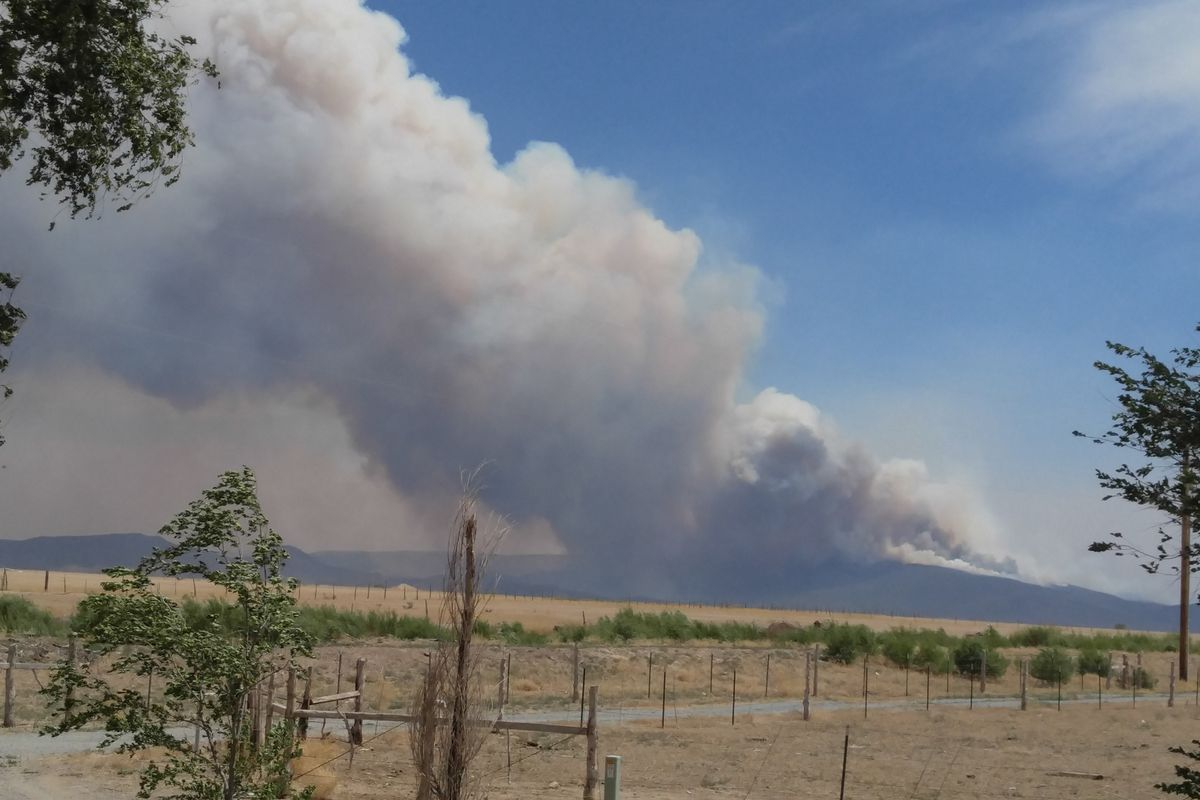 Firefighters are working to put out a wildfire in southern Utah, already estimated at 4,000 acres, that ignited Thursday and quickly spread to threaten a town.
