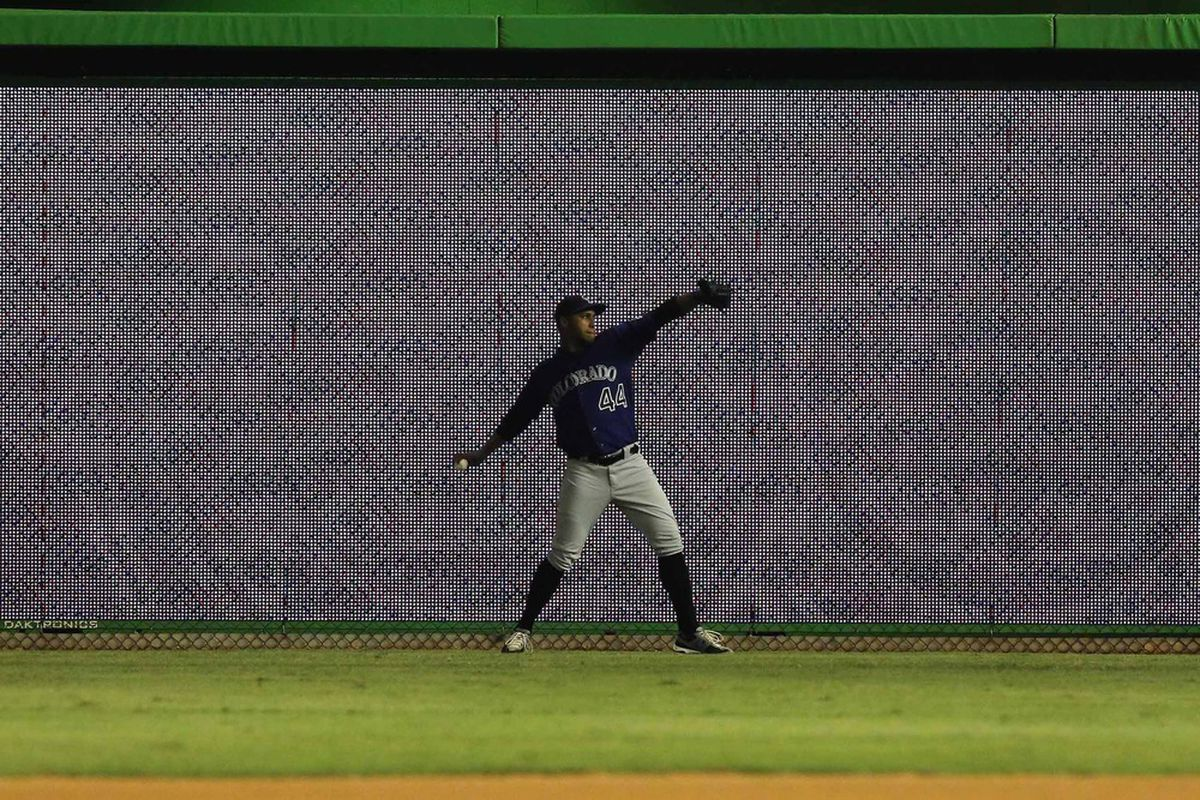May 22, 2012; Miami, FL, USA; Colorado Rockies starting pitcher Juan Nicasio (44) warms up before a game against the Miami Marlins at Marlins Park. Mandatory Credit: Robert Mayer-US PRESSWIRE