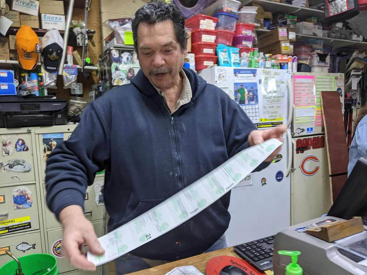 """Capt. William """"Augie"""" Ralph, who passed away last week, printed out my license at the Salmon Stop bait/tackle shop in Waukegan this spring. Credit: Dale Bowman"""