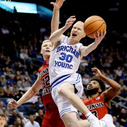 BYU guard TJ Haws shoots the ball with Illinois State Redbirds forward Taylor Bruninga defending in Provo on Wednesday, Dec. 6, 2017.