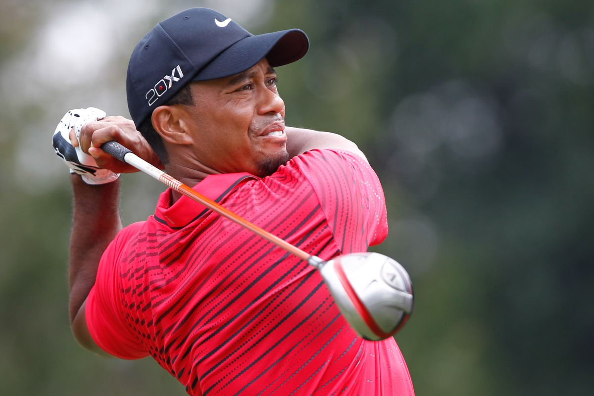 Aug. 5, 2012; Akron, OH, USA; Tiger Woods tees off during the final round of the WGC-Bridgestone Invitational at Firestone Country Club-South Course.  Mandatory Credit: Debby Wong-US PRESSWIRE