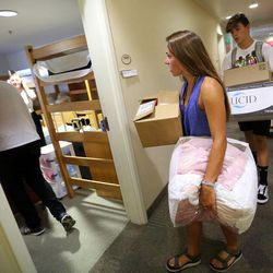 Heather Boland and her brother, Garrett Boland, move her belongings into her dorm room at the University of Utah in Salt Lake City on Thursday, Aug. 17, 2017.
