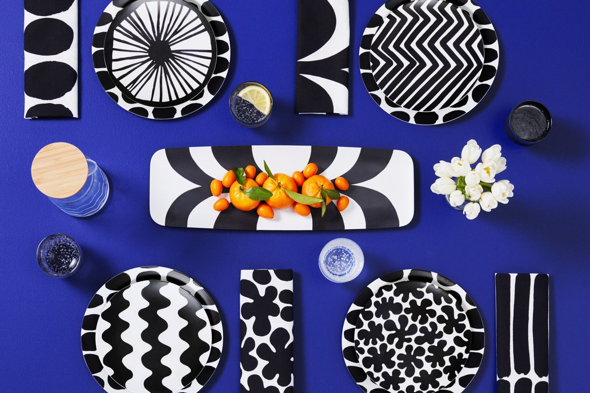 Top view of a tableware spread featuring items with black and white patterns.