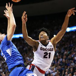 Brigham Young Cougars guard Zac Seljaas (2) tries to grab the ball as Gonzaga Bulldogs forward Rui Hachimura (21) falls away as BYU and Gonzaga play in an NCAA basketball game in the Marriott Center in Provo on Saturday, Feb. 24, 2018. Gonzaga won 79-65.