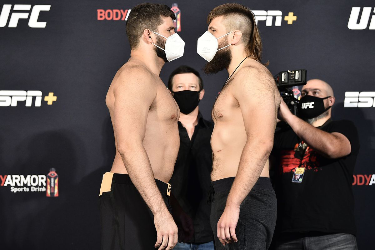 Opponents Philipe Lins of Brazil and Tanner Boser face off during the UFC weigh-in at UFC APEX on June 26, 2020 in Las Vegas, Nevada.
