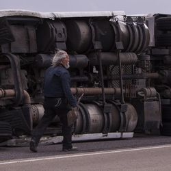 Bob Williams prepares to clean the road after semitrailer was toppled by the wind on I-80 near Dugway on Monday, June 12, 2017.