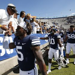 Brigham Young Cougars players high five the fans in Provo on Saturday, Aug. 26, 2017. BYU won 20-6.