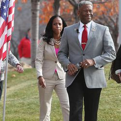 Former Congressman and retired Army Lt. Col. Allen West and congressional hopeful Mia Love walk to a town hall at the Salt Lake Community College in Sandy on Wednesday, Nov. 13, 2013.