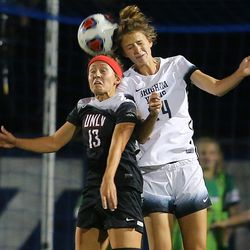 UNLV Dakota Blazak (13) and BYU Stephanie Ringwood (24) head the ball as BYU and UNLV play in the first round of the NCAA tournament in Provo on Friday, Nov. 11, 2016.
