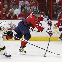 Washington Capitals left wing Alex Ovechkin (8) shoots the puck as Boston Bruins right wing Shawn Thornton (22) defends during the second period of Game 4 in a first-round NHL Stanley Cup playoff hockey series, Thursday, April 19, 2012, in Washington. The Capitals defeated the Bruins 2-1.