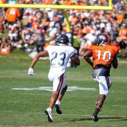 Denver Broncos WR Emmanuel Sanders (10) looks to get a step on Chicago Bears DB Kyle Fuller (23) during the joint training camp practice.