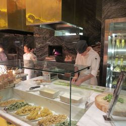 The pasta station is constantly rolling new raviolis, bucatinis and more.