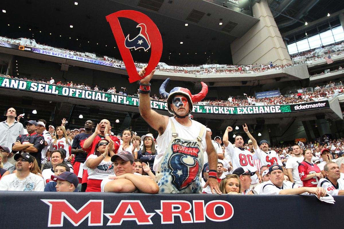 HOUSTON, TX - SEPTEMBER 11:  Houston Texans fans cheer against the Indianapolis Colts on September 11, 2011 at Reliant Stadium in Houston, Texas. Texans won 34 to 7.(Photo by Thomas B. Shea/Getty Images)
