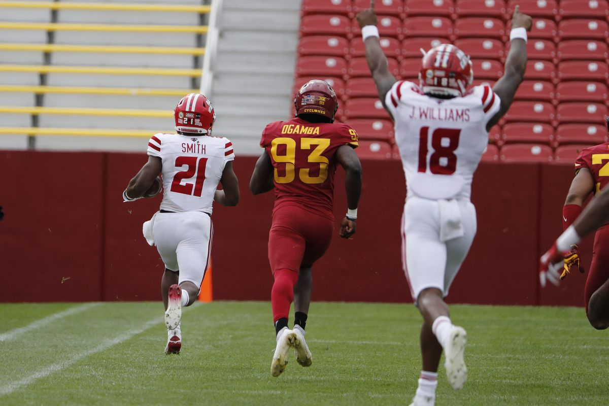 Running back Chris Smith of the Louisiana-Lafayette Ragin Cajuns runs back a kick for a touchdown as his teammate wide receiver Jalen Williams of the Louisiana-Lafayette Ragin Cajuns signals touchdown while place kicker Eddie Ogamba of the Iowa State Cyclones defends in the first half of the play at Jack Trice Stadium on September 12, 2020 in Ames, Iowa.