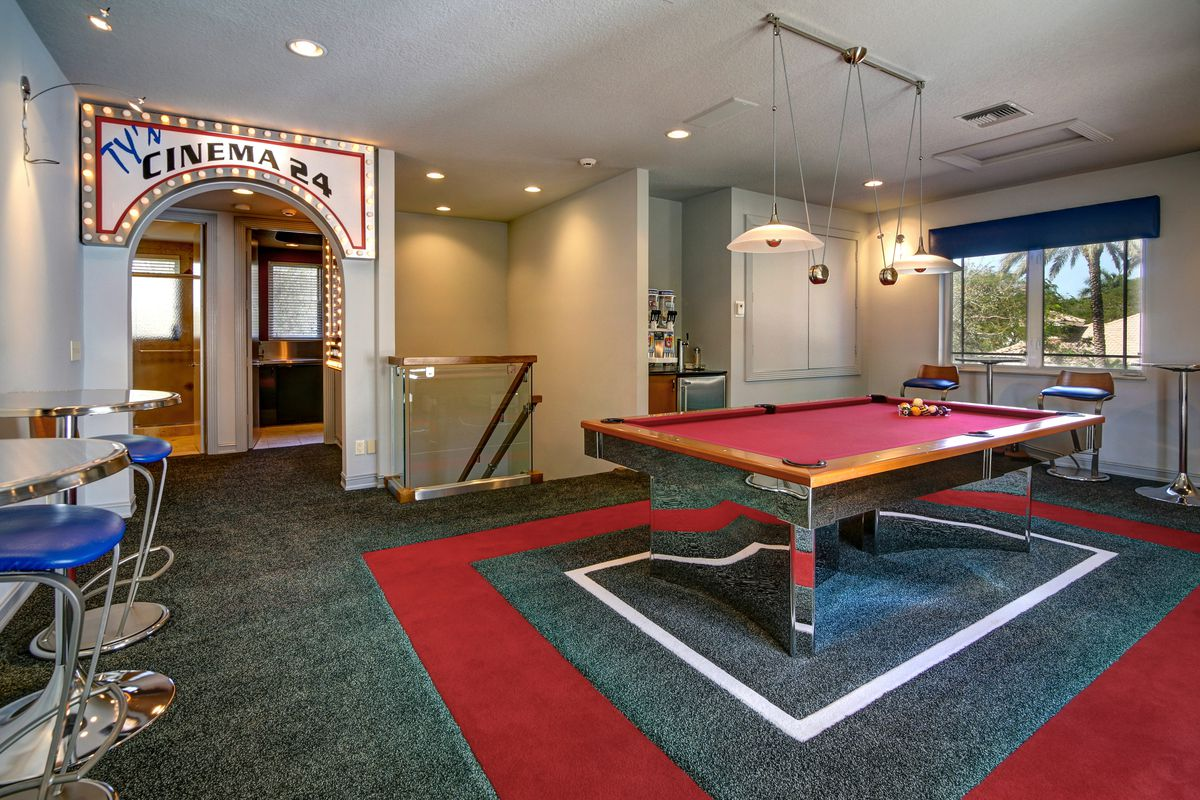 Inside the game room of Ty Law's Plantation home, with a pool table and much more