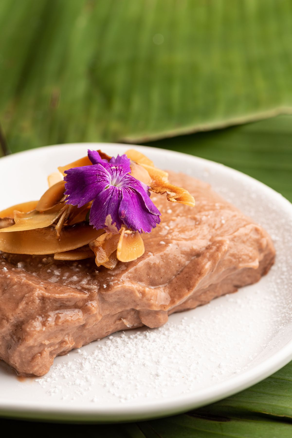 Tembleque, Puerto Rican panna cotta, chocolate coconut with powdered sugar