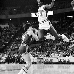 The Utah Jazz' Pete Maravich looks for a teammate as he finds the route to the basket blocked by Denver Nugget David Thompson in Denver on Oct. 27, 1979. The Nuggets were looking for their first win of the season.