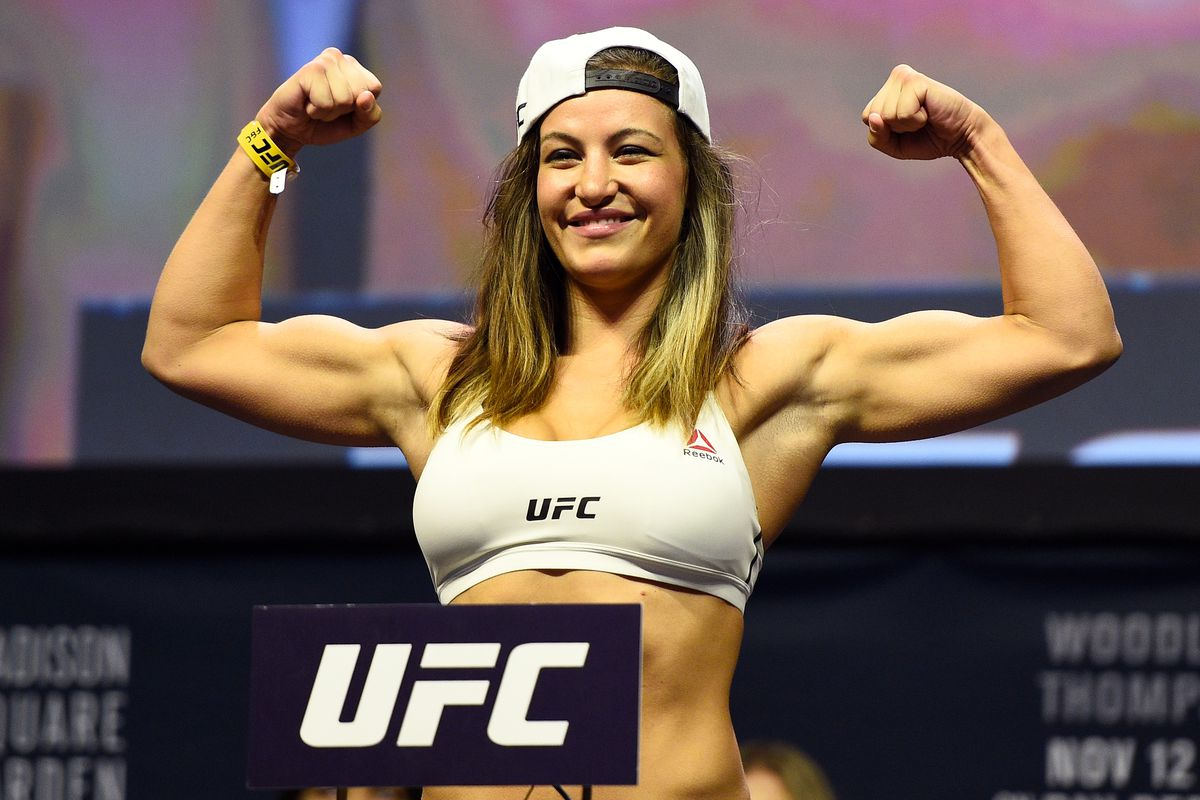 Miesha Tate weighing in for her fight with Raquel Pennington at UFC 205