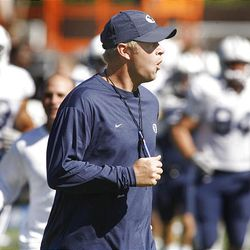 BYU head football coach Bronco Mendenhall calls out instructions as the team runs from one drill to another during day 10 of fall football camp.