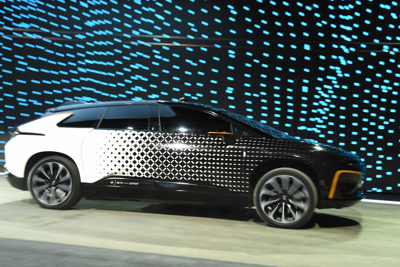 faraday future starts construction at its california factory while paying back some debts