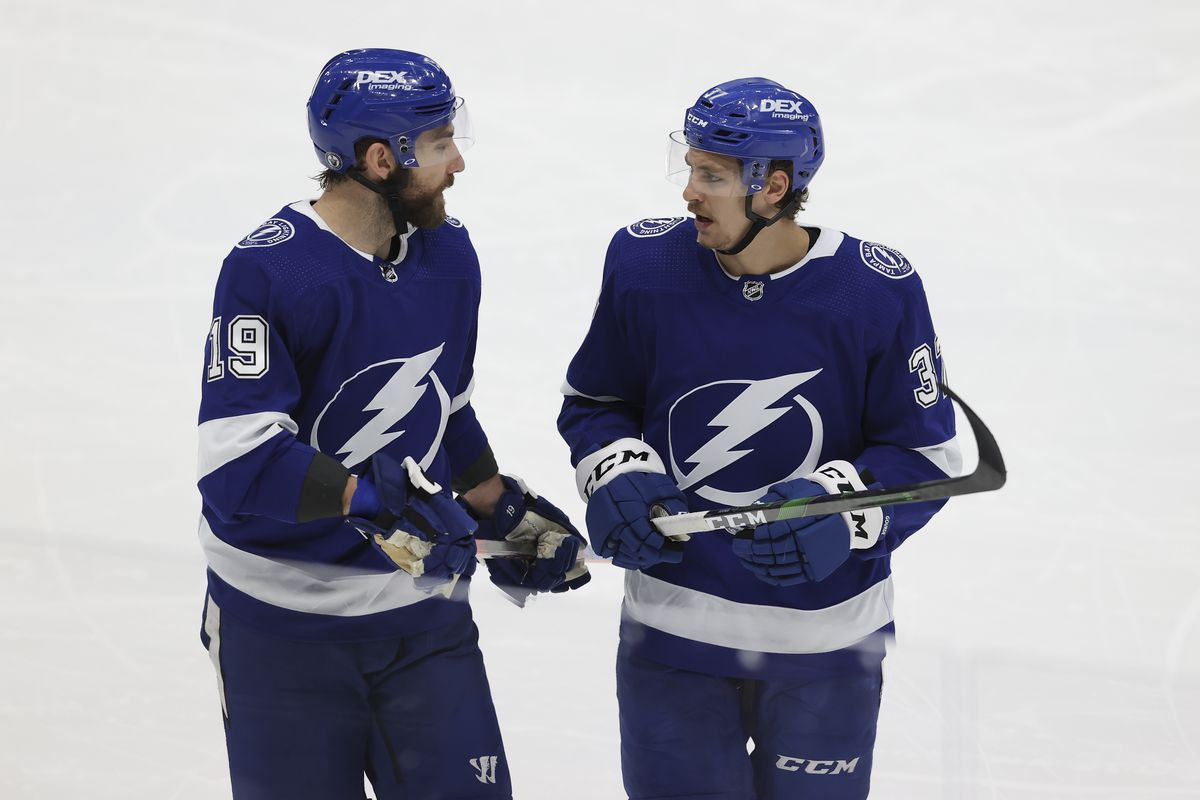 Tampa Bay Lightning right wing Barclay Goodrow (19) talks to Tampa Bay Lightning center Yanni Gourde (37) during Game 3 of the Second Round of the Stanley Cup Playoffs between the Carolina Hurricanes and Tampa Bay Lightning on June 03, 2021 at Amalie Arena in Tampa, FL.