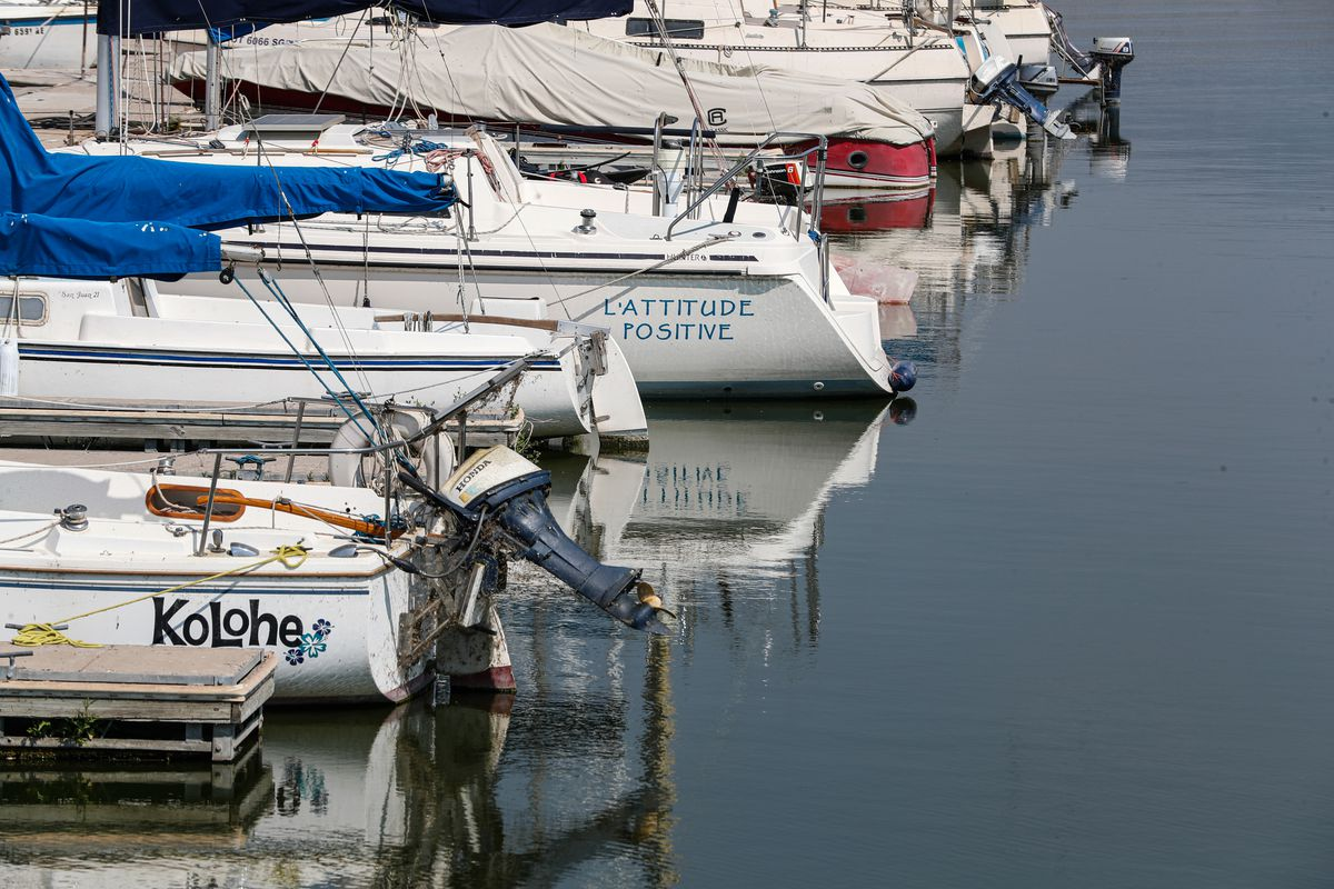 Boats are reflected in the water at Utah Lake's Lindon Marina in Vineyard on Monday, Aug. 24, 2020.