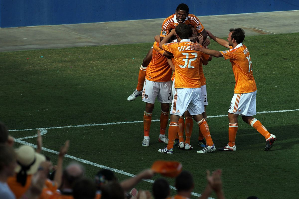 FRISCO, TX - SEPTEMBER 24:  Carlo Costly #29 of the Houston Dynamo celebrates a goal with his team against FC Dallas at Pizza Hut Park on September 24, 2011 in Frisco, Texas.  (Photo by Ronald Martinez/Getty Images)