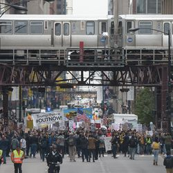 Protesters marched through downtown Chicago after rallying across the river from Trump International Hotel and Tower in Chicago on Monday, October 28, 2019.