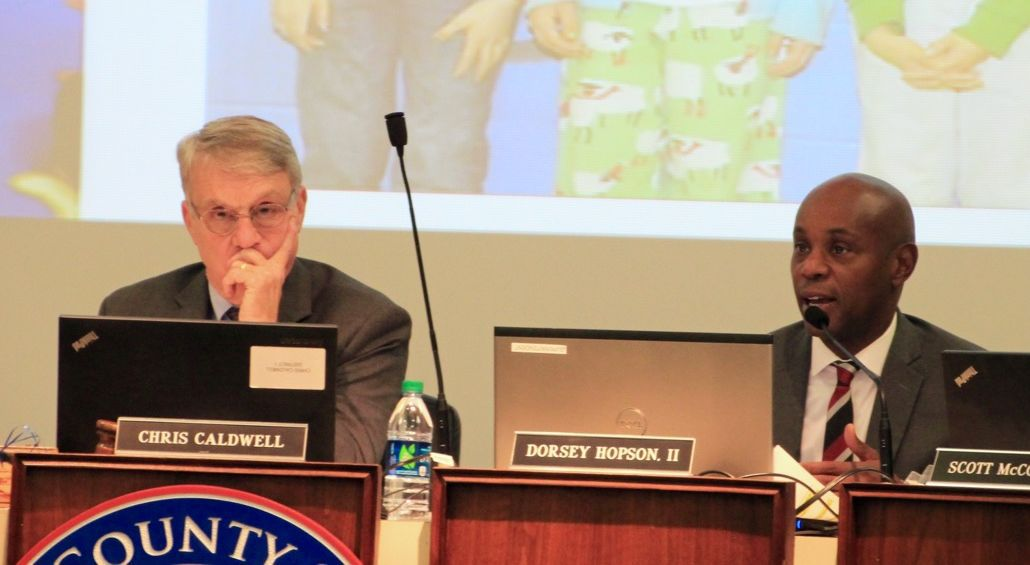 Chairman Chris Caldwell looks on while Superintendent Dorsey Hopson presents his plan.