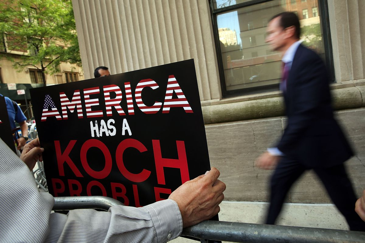 Demonstrators protest against the campaign contributions by the billionaire Koch brothers who are owners of Koch Industries.