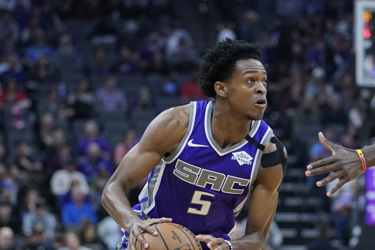 De'Aaron Fox of the Sacramento Kings dribbles the ball against the Toronto Raptors during the first half of an NBA basketball game at Golden 1 Center on March 08, 2020 in Sacramento, California.