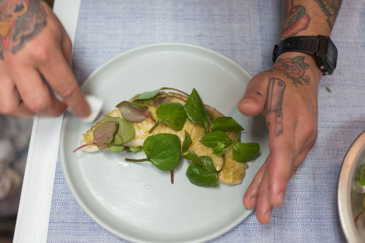 A chef plates a skate wing