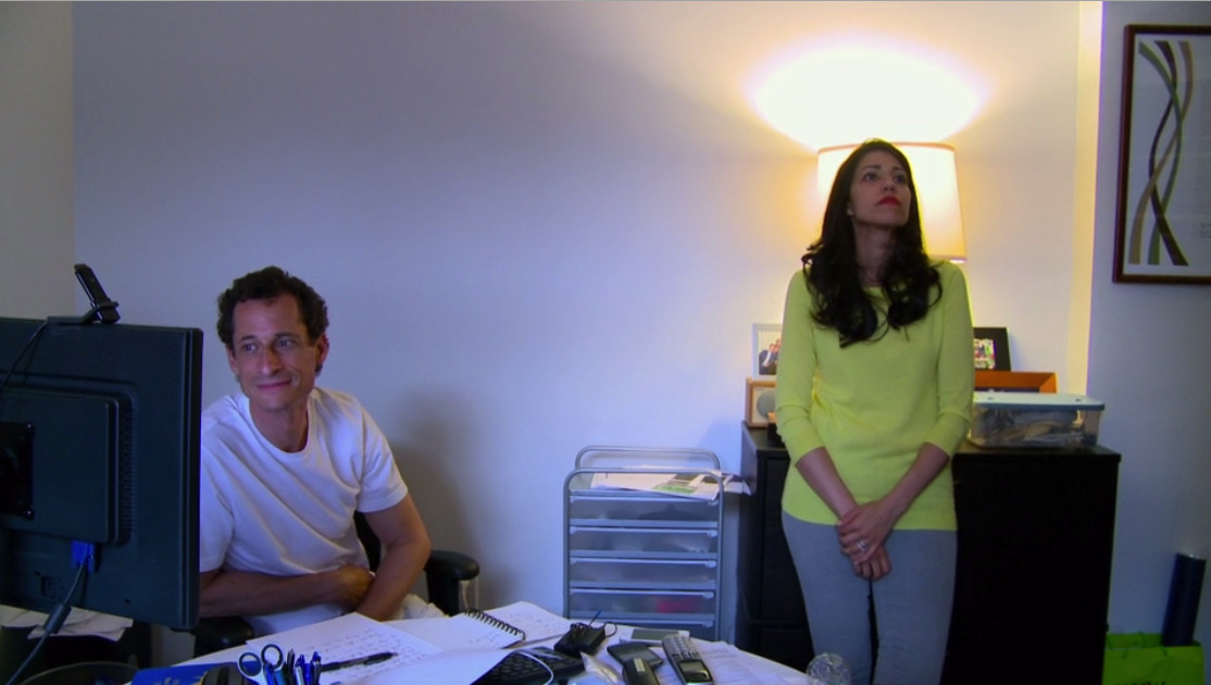 Anthony Weiner watches a clip of himself on The Last Word. Huma Abedin looks away.